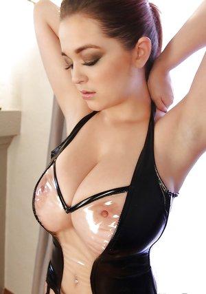 Big-tit brunette Tessa Fowler poses in a hot latex harness in close-up