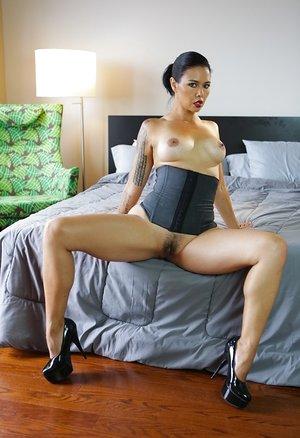 Solo model Dana Vespoli unwraps her bra and panties to model in a corset