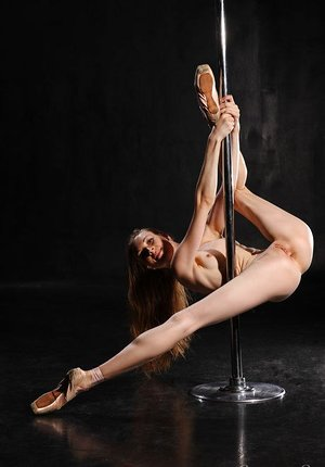 Acrobatic Annett A spreads long legs naked to pole dance displaying bald muff