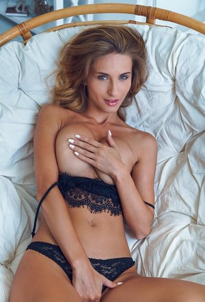 Teen glamour model Cara Mell slips off her ebony lingerie ensemble
