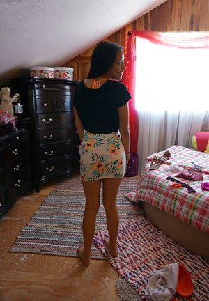 Eighteen year old teen Maya Bijou undresses her clothes while holding plush toy