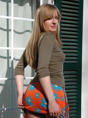 Slender scorching teen Kristin flashing a splendid upskirt wearing lace thong panties