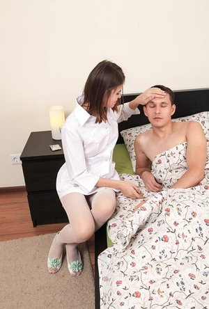 Young Euro nurse in white stockings has unique way to take man's temperature