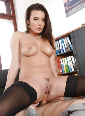 Curvy brunette in stockings and high high-heeled slippers Vanessa Decker is screwed on table