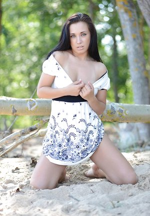 Sexy brunette Friski gets on her knees naked in the woods to spread legs open