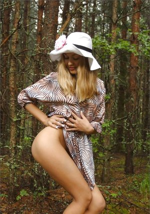 Cute light-haired Delicious Lilya lifts dress for sexy upskirt in the woods & romps nude