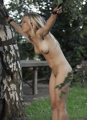 Young platinum-blonde girl is tantalized in the backyard by her captor