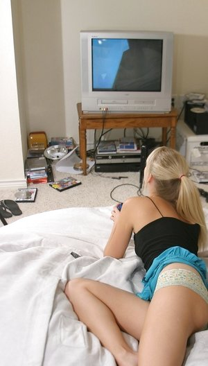 Pretty Jana Jordan playing video games in her inviting panties