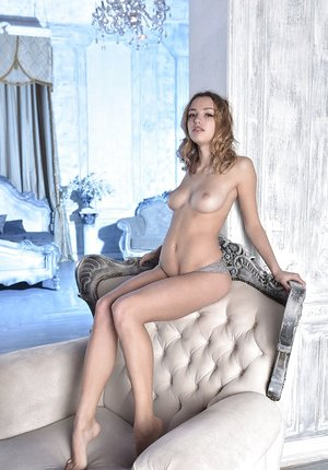 Erotic beauty Maxa undressing to spread naked showing perfect petite caboose