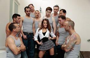 Tiny cockslut Megan Rain deep-throats off and takes facials from 10 guys at once