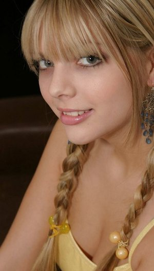 Sweet teenage girl Jana Jordan models non nude with her hair in pigtails