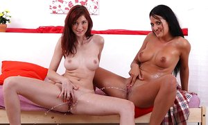Lezzie girls Kattie Gold & Nicole Vice drench each other in pee and toy