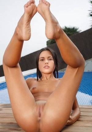Stunning raven-haired looker Apolonia loves spreading her sexy legs