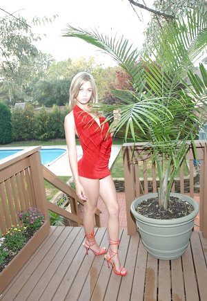 Young blonde girl Teen Kasia flaunts her upskirt ass in a red thong on patio