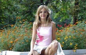 Petite teen amateur flashes a no g-string upskirt in a public park