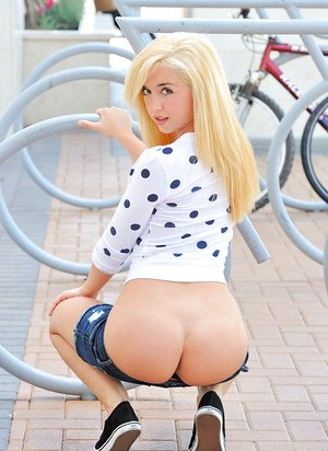 Hot youthfull ash-blonde with perky tits in shorts baring small round arse in public