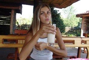 Young blonde fledgling flashes nude upskirt while enjoying milkshake outdoors