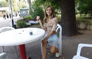 Young blonde amateur eating ice-cream posing non nude in public