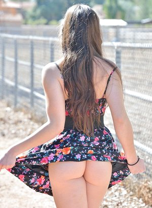 Youthfull teen spreads ass for naked upskirt & toys pussy outdoors