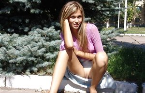 Naughty platinum-blonde teenage flashes a no panty upskirt and a boob on the front lawn