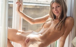 Slim young female Gina G doffs sheer lingerie to strike hot poses in the nude