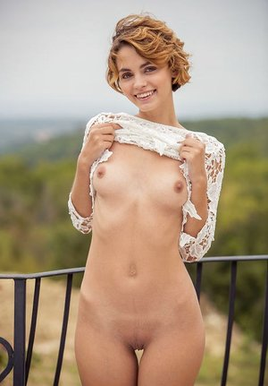 Teen sol woman Ariel A poses her beautiful figure in the nude on balcony