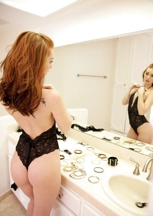 Red-haired cutie Natalie Lust determined to play with herself before the party