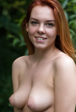 Natural redhead Candy Crimson an her pointy knockers go for a nude walk in the forest