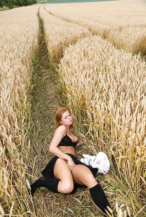 Blonde schoolgirl Chrissy Fox fingers her bald pussy amid a field of wheat