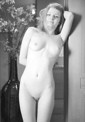 Teen solo girl Liza shows off her nude body on a chair after removing tan hose