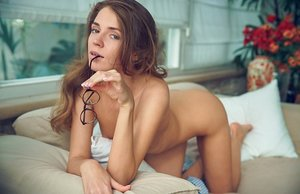 Petite Russian dame Kalisy turns to flaunt her tight ass in the nude