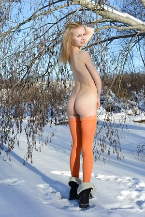Cold winter day isn't a problem for skinny babe in orange tights Angelika D