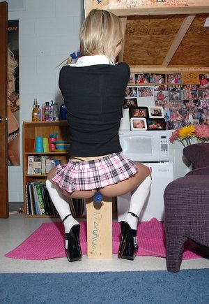 Sexy blonde teen Kasia in micro skirt and socks bending over to flash her ass