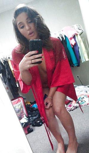 Self shots of buxom teenager Abella Banger getting dressed