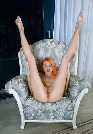 Orange haired Beatrice Roja spreading long legs super wide to show cute pussy
