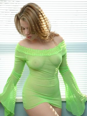 Big titted Kerie Hart in sheer dress flaunting bare round ass in naked upskirt