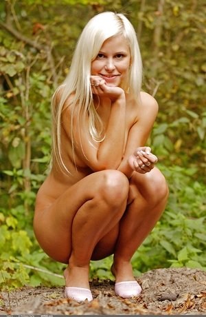 Skinny pure tenderness Dido A with blonde hair and tiny pussy poses outdoors