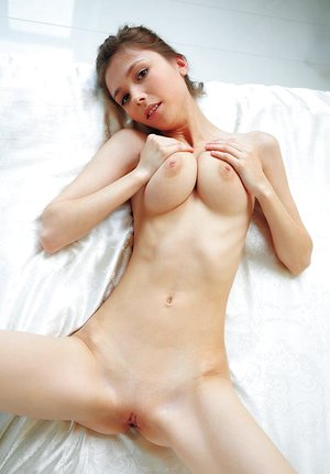 Sweet youthful Milla D reveals her innate fat breasts spreading to show tiny vagina