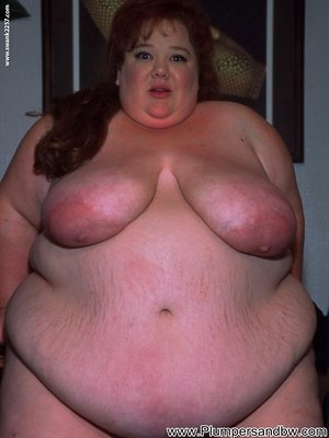 SSBBW with red hair pinches her nipples while sucking cock and fucking
