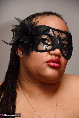 SSBBW wears a mask while unveiling her huge saggy baps and thick ass