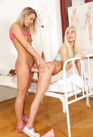 Young blond girls get handed vibrators and are off to explore lesbian sex