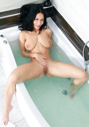 Teenage babe Mila M shedding bikini in shower to flaunt adorable butt