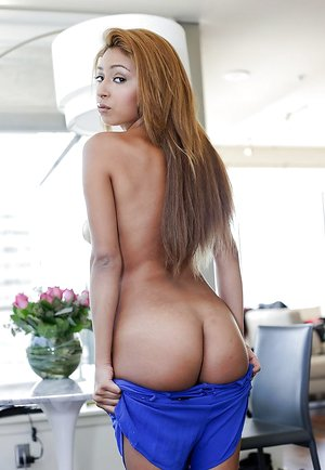 Slick suntanned babe Sarai spreading her legs and undresses hot