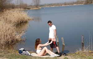 Horny teen girl deep throats the cum from her guy's cock after hook-up by the water