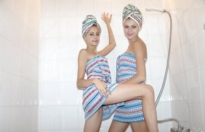 Cute amateur babes Laura & Katrina pose in the bathroom after taking a shower