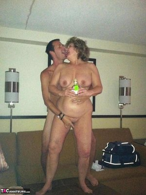Wild granny BustyBliss oils up floppy tits & spreads pussy for hotel boy toy