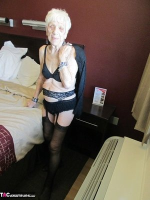Ancient older woman in black lingerie gets her mature old granny cunny penetrated