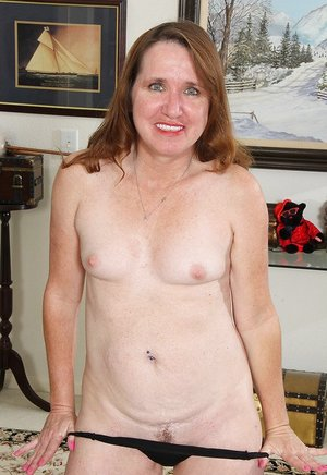 Mature woman Terri Pazelli in sheer lingerie disrobes to toy her horny snatch