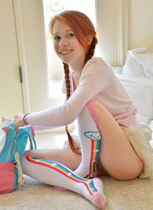 Youthfull redhead in pigtails flashes pussy at the playground & toys in socks