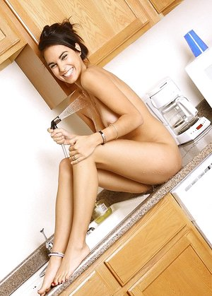 Fantastic housewife Rachel washing her sexy naked body on the kitchen counter